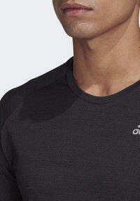adidas Performance - SUPERNOVA PRIMEGREEN RUNNING SHORT SLEEVE TEE - Print T-shirt - black - 5