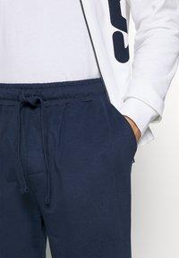Fila - BRUSHED FEECE PYJAMAS WITH FULL ZIP - Pyjamas - white - 5
