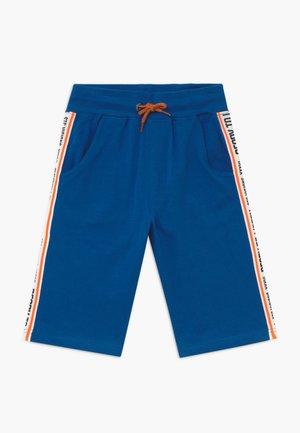 BERMUDAS KID - Tracksuit bottoms - blue/orange/white