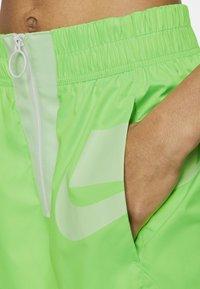 Nike Sportswear - Tracksuit bottoms - green strike/vapour green/white - 3