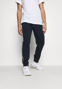 Champion - CUFF PANTS - Tracksuit bottoms - dark blue - 3