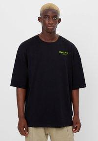 Bershka - MIT ESOTERISCHEM PRINT - Print T-shirt - black - 0