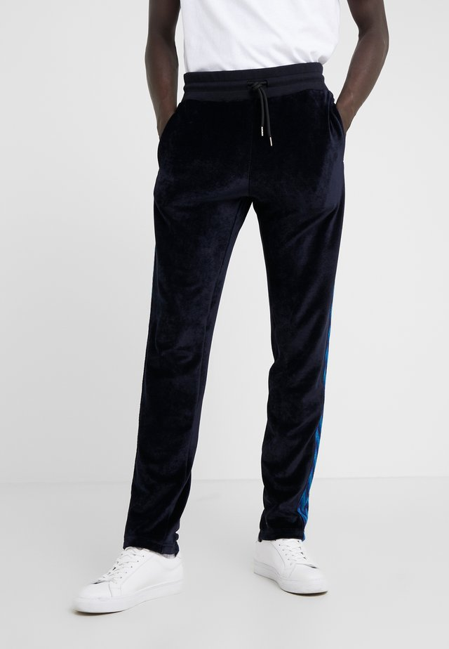 TRACK TROUSERS - Tracksuit bottoms - dark blue