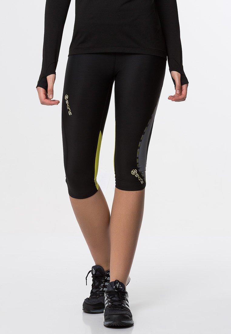 Skins - DNAMIC - 3/4 sports trousers - black/limoncello