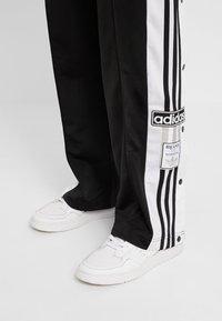 adidas Originals - ADIBREAK PANT - Tracksuit bottoms - black - 7