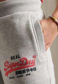 Superdry - Tracksuit bottoms - light grey marl - 2