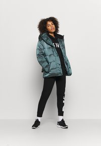 DKNY - BELTED PUFFER - Training jacket - blue - 1