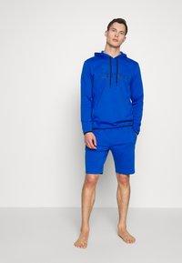 Calvin Klein Underwear - HOODIE - Camiseta de pijama - blue - 1