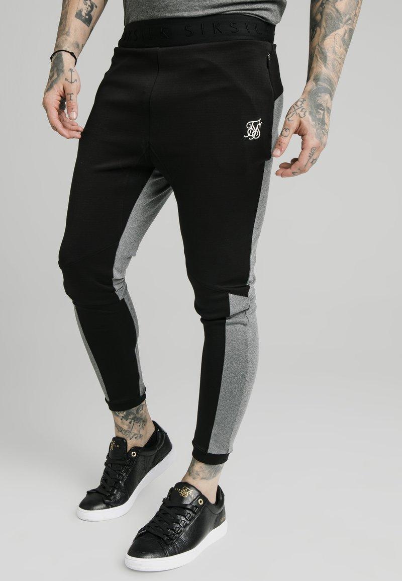 SIKSILK - ENDURANCE TRACK PANTS - Pantaloni sportivi - grey/black