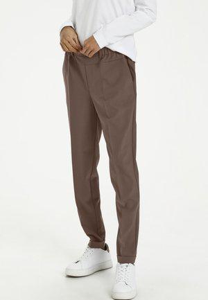 NANCI JILLIAN - Trousers - shopping bag