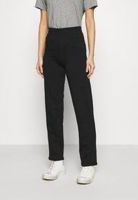 Marks & Spencer London - JOGGER - Tracksuit bottoms - black - 0