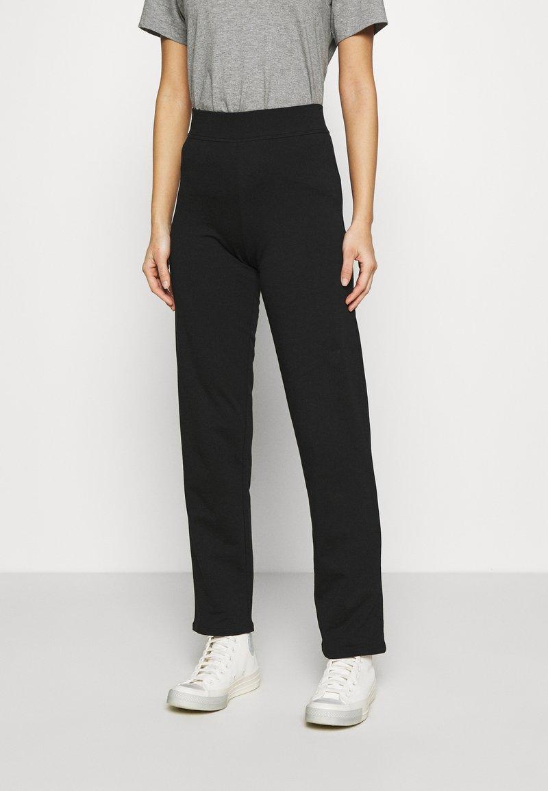 Marks & Spencer London - JOGGER - Tracksuit bottoms - black