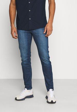 SLIM TAPER - Slim fit jeans - denim medium