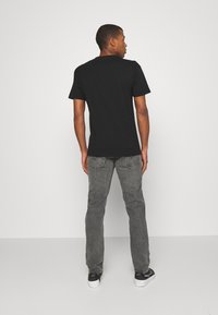 Levi's® - 511™ SLIM - Slim fit jeans - undercast adv - 2