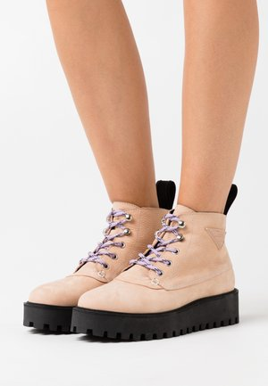 ROCKY - Ankle boots - cream