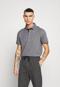 Calvin Klein - LIQUID HEATHER - Polo shirt - black - 0