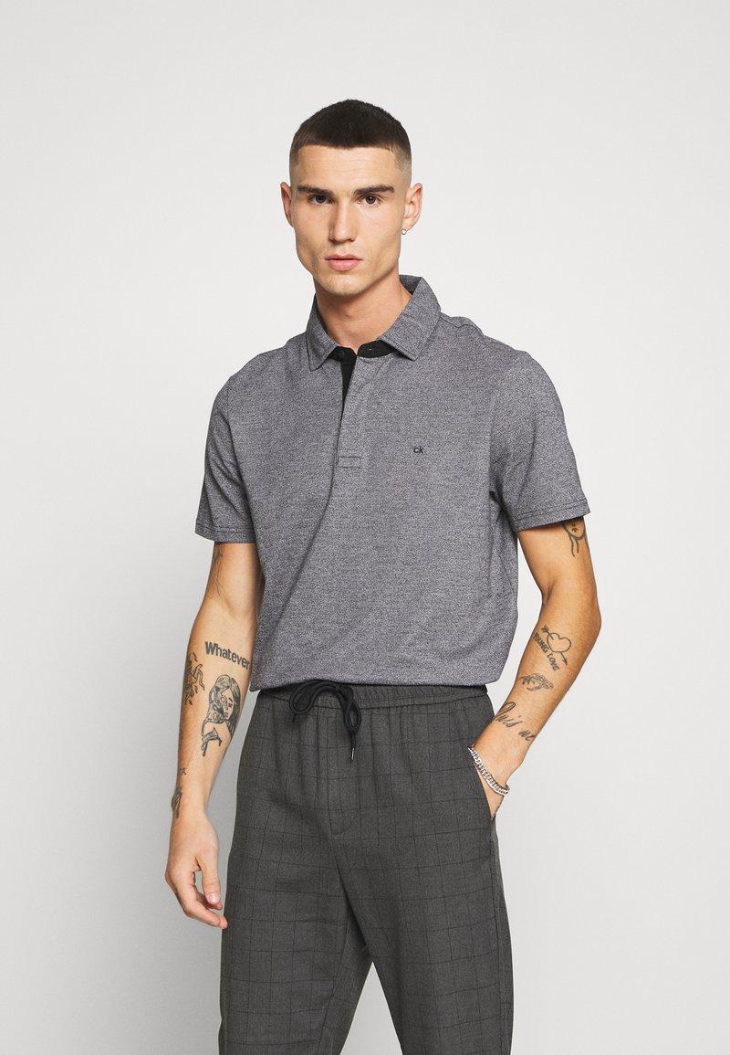 Calvin Klein - LIQUID HEATHER - Polo shirt - black