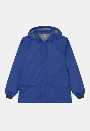 TAIN UNISEX - Waterproof jacket - surf