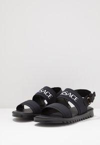 Versace - Sandals - nero/oro caldo - 3
