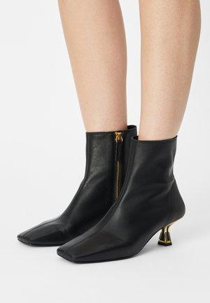 TASNIM - Classic ankle boots - black/gold