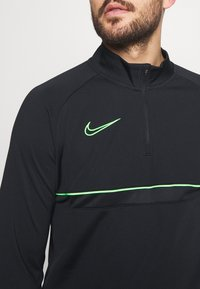 Nike Performance - Sports shirt - black/green strike - 3