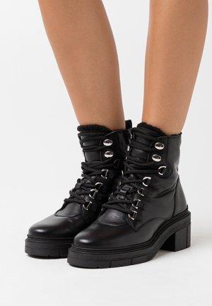 JIMUL - Platform ankle boots - black
