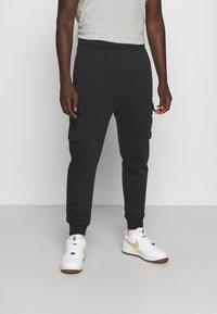 Nike Sportswear - CARGO PANT - Träningsbyxor - black - 0