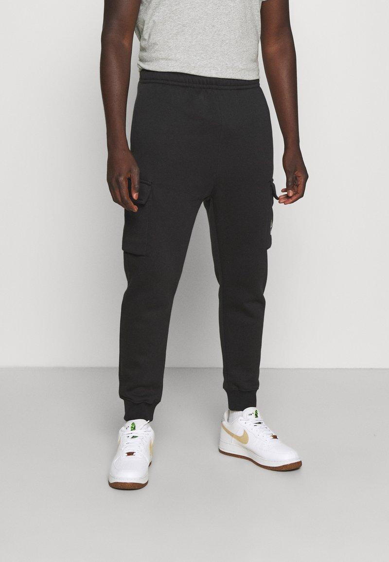 Nike Sportswear - CARGO PANT - Träningsbyxor - black