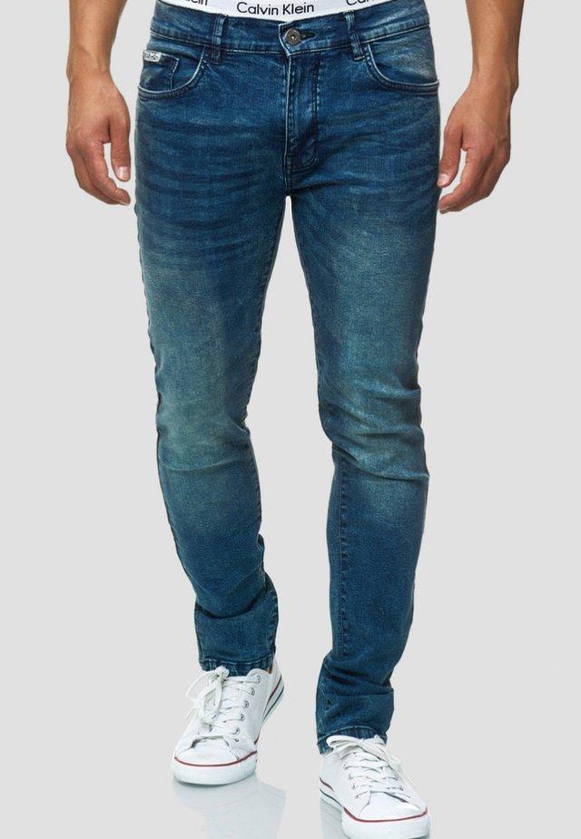 HYDRO FLEX - Slim fit jeans - dark blue