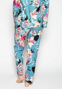 Cyberjammies - Pyjamahousut/-shortsit - turq floral - 2