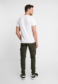 Alpha Industries - PETROL PATCH - Cargo trousers - greyblack - 2