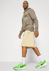 Reebok Classic - CLASSIC NATURAL DYE - Tracksuit bottoms - sepia - 3