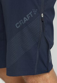 Craft - ROUTE SHORTS 2-IN-1 - kurze Sporthose - blaze - 4