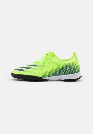 X GHOSTED.3 FOOTBALL BOOTS TURF UNISEX - Korki Turfy - signal green