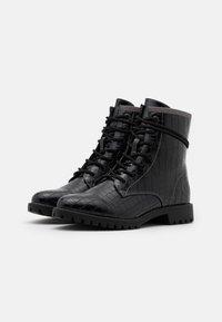 s.Oliver - Šněrovací kotníkové boty - black - 2