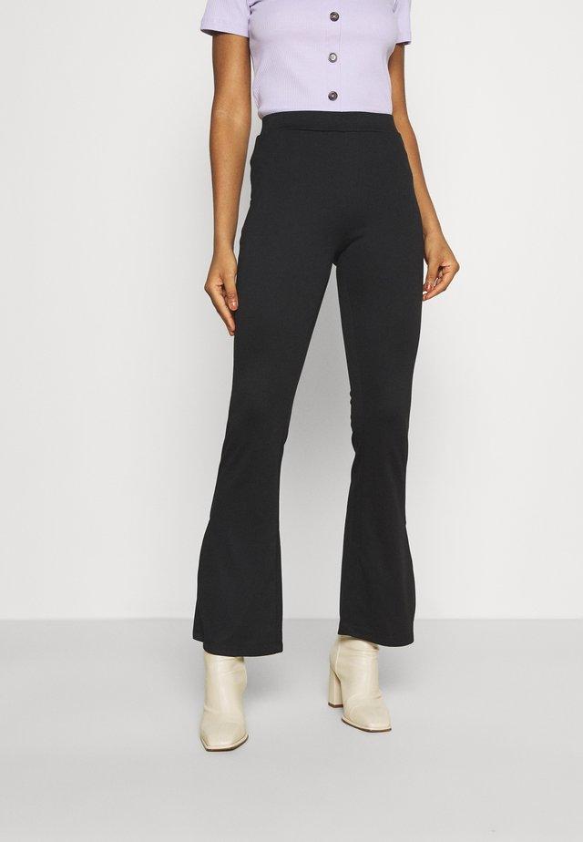 VITINNY FLARED - Leggings - black