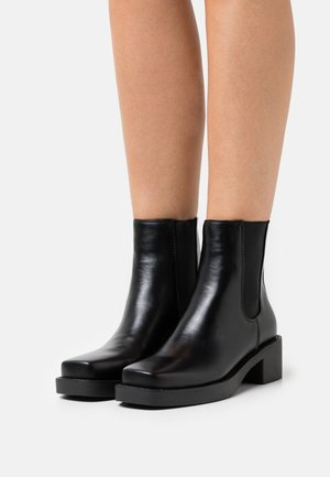 DEMELZA - Platform ankle boots - black