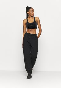 Juicy Couture - IVY - Tracksuit bottoms - black - 1