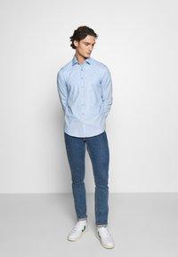 Calvin Klein Tailored - DOBBY EASY CARE SLIM - Formal shirt - blue - 1
