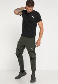 Puma - ACTIVE TEE - T-shirts - black - 1
