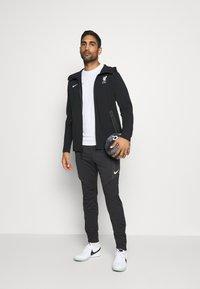 Nike Performance - DRY STRIKE WINTERIZED - Tracksuit bottoms - black/volt - 1