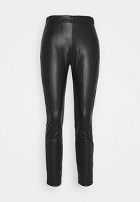 RANGHI - Leggings - Trousers - schwarz