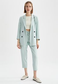 DeFacto - Tracksuit bottoms - turquoise - 1