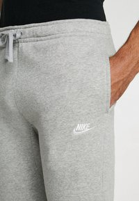 Nike Sportswear - CLUB CUFFED PANT - Tracksuit bottoms - dark grey heather/white - 5