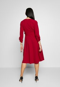 DKNY - RUCHED COVERED BUTTON SLEEVE FAUX WRAP FIT & FLARE - Jersey dress - scarlet - 2