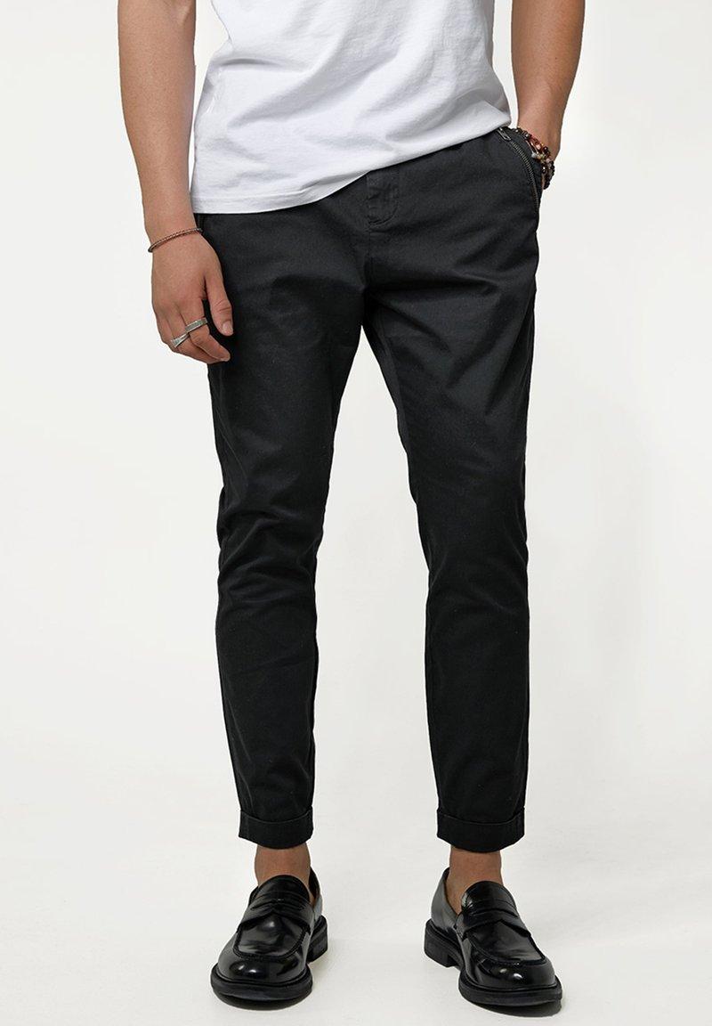 Tigha - Trousers - black