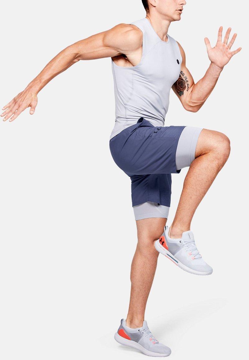 Under Armour - VANISH SHORTS - Sports shorts - blue ink