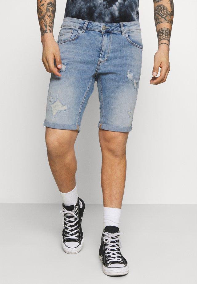 Jeans Short / cowboy shorts - light destroyed