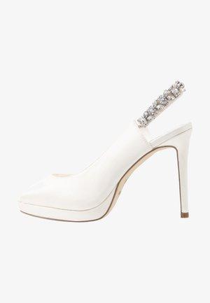 Peeptoe heels - marfil