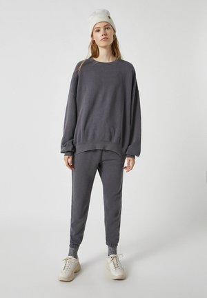 Teplákové kalhoty - mottled dark grey